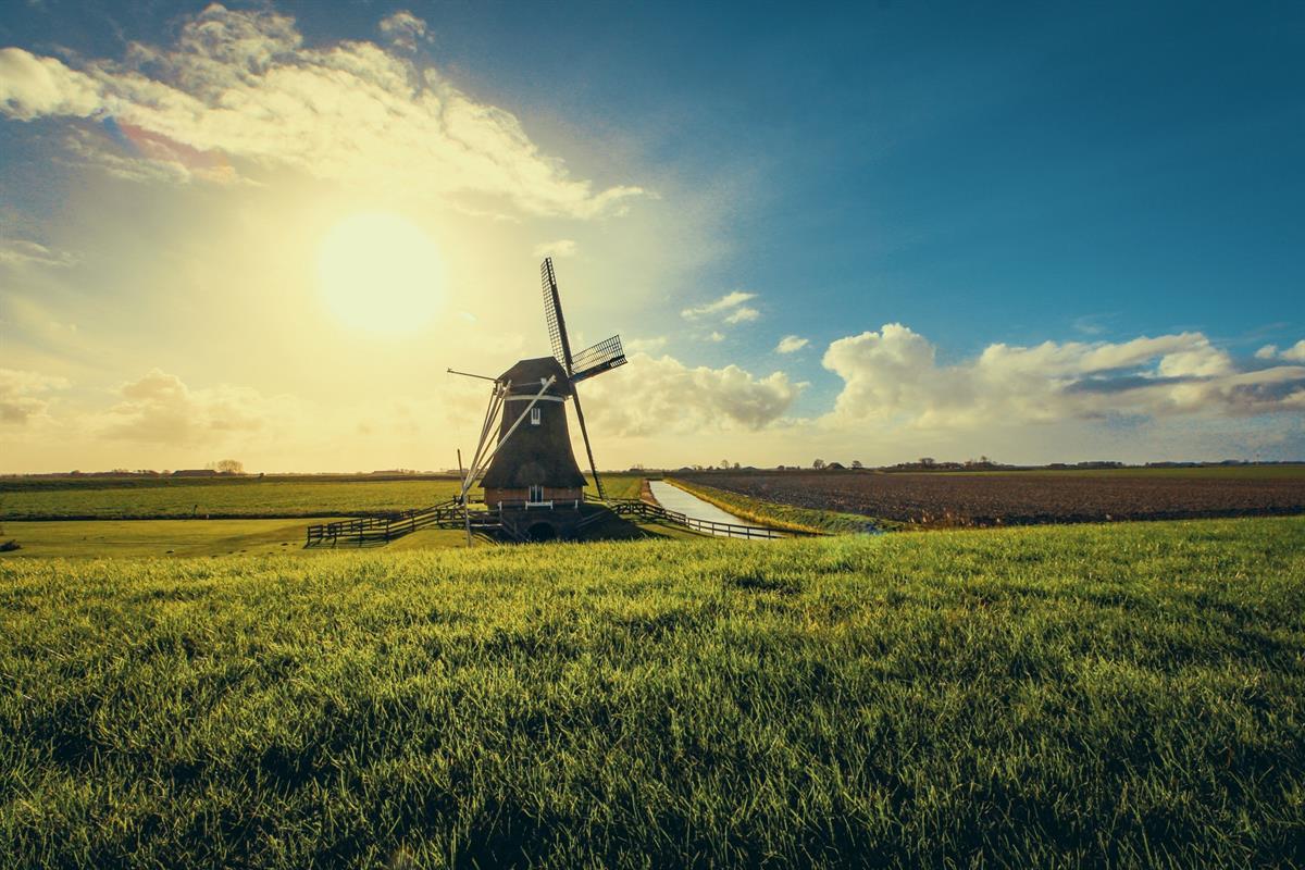 vintage-black-windmill-during-sunset-952632